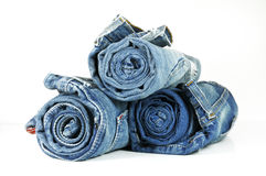 Rolled blue jeans. Three washed-out rolled blue jeans isolated on white background Stock Image
