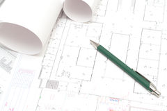 Rolled blueprints and a pen. Arhitectural construction document and plans and a pen Royalty Free Stock Photography