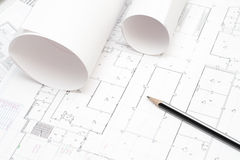 Rolled blueprints and a pencil. Arhitectural construction document and plans and a pencil Stock Photography