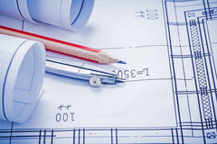 Rolled blueprints pencil compass close up Royalty Free Stock Photos