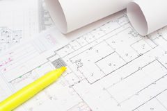 Rolled blueprints and yellow marker. Arhitectural construction document and plans and yellow marker Royalty Free Stock Photo