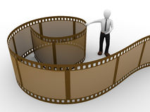 Rolled brown film man. A man with a brown rolled film Royalty Free Stock Photo