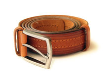 Rolled brown leather belt. Brown leather belt with metal buckle Royalty Free Stock Photos