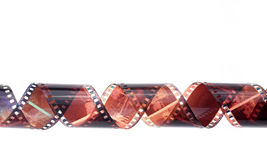 Rolled camera film strip on white background stock photo