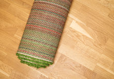 Rolled carpet on the floor Royalty Free Stock Photography