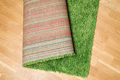 Rolled carpet on the floor Stock Photos