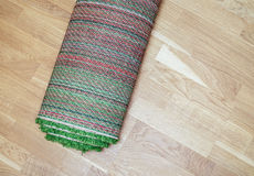 Rolled carpet on the floor Stock Image