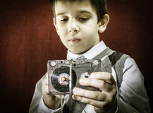 Rolled cassette strip with a pencil. Boy hold cassette tape. Royalty Free Stock Photos