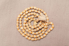 Rolled chanting beads Stock Images