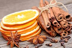 Rolled of cinnamon sticks with sliced of dried orange clove and Royalty Free Stock Photo