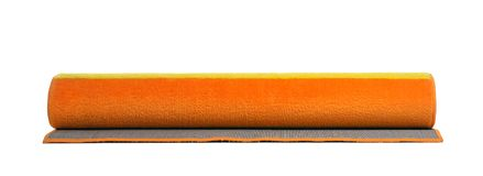 Rolled colorful carpet on white background. Interior element stock image