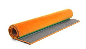 Rolled colorful carpet on white background. Interior element royalty free stock photos