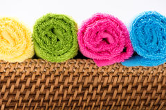 Rolled, colorful towels in a basket Stock Image