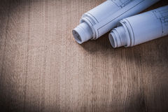 Rolled construction drawings on wood board architecture and buil Royalty Free Stock Photography