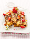 Rolled crepes with fresh strawberries stock photos