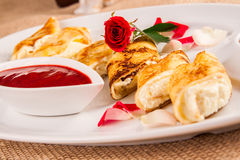 Rolled crepes stuffed with curd and berry jam Royalty Free Stock Photos