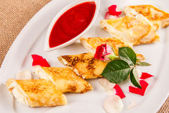 Rolled crepes stuffed with curd and berry jam Royalty Free Stock Image