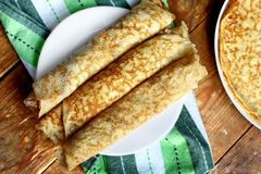 Rolled crepes. Three home made pancakes rolled on a plate Royalty Free Stock Photography
