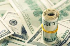 Rolled $100 dollar bills. Closeup of rolled $100 dollar bills royalty free stock photo