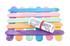 Rolled dollar with a red rubber band Royalty Free Stock Photos