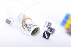 Rolled dollar with a rubber band Royalty Free Stock Photography