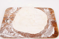 Rolled dough on wooden cutting board, free space Stock Images