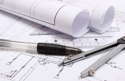 Rolled electrical diagrams and accessories for drawing Royalty Free Stock Photos
