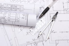 Rolled electrical diagrams and accessories for drawing Royalty Free Stock Images
