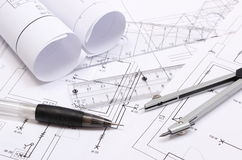 Rolled electrical diagrams and accessories for drawing Stock Photo
