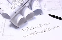 Rolled electrical diagrams and mathematical calculations. For project, drawings for the projects engineer jobs Royalty Free Stock Photos