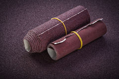 Rolled emery paper top view abrasive tools.  Royalty Free Stock Images