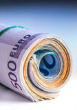 Rolled euro banknotes several thousand.Free space for your economic information Stock Photos