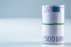 Rolled euro banknotes several thousand.Free space for your economic information Royalty Free Stock Image