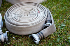 Rolled fire hose Royalty Free Stock Photo