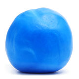 Rolled fondant ball. A ball of blue rolled fondant on a white background royalty free stock image