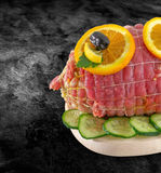 Rolled fresh ham meat in tied - veal roulade. Raw rolled meat enclosed in net netting with spices - ready to barbecue-bbq and clip Royalty Free Stock Images