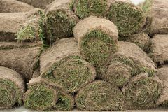 The rolled grass is stacked, ready for gardening, concept stock photography