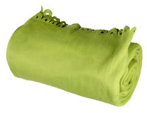 Rolled green blanket Stock Photo