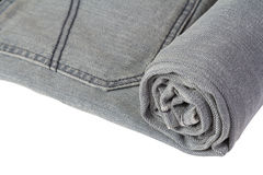Rolled grey jeans Stock Image