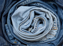 Rolled jeans. Light-blue and blue jeans rolled together Stock Photos