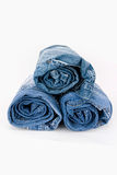 Rolled jeans. On a white background royalty free stock image