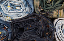 Rolled jeans of different colors royalty free stock photography