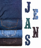 Rolled jeans and inscription. Jeans stock image