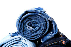 Rolled jeans on white Royalty Free Stock Photography
