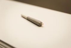 Rolled joint or cigarette with crutch and twisted tip stock photo