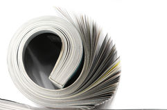 Rolled magazine Stock Photos