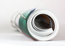 Rolled magazine Stock Photos