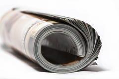 Rolled magazine. Rolled up magazine on white background Royalty Free Stock Images