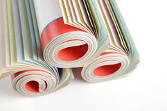 Rolled magazine. Macro colorful rolled magazine background Royalty Free Stock Photo