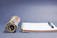 Rolled magazine and notebook. Back to school, back to work Royalty Free Stock Images